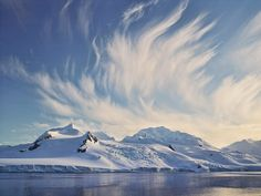 Antarctica winds create a dramatic cloud formation in the South.