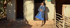 Berthine, poses in front of her newly built latrine and shower. World Toilet Day, You Are The World, Poses, Shower, Figure Poses, Rain Shower Heads, Showers