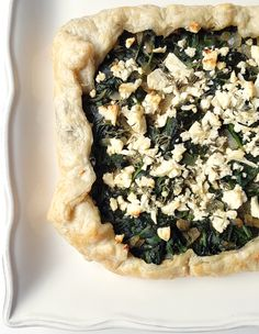 Spinach and feta come together with a puff pastry crust in this galette. Perfect for a light lunch or dinner. Recipe at MouthHalfFull.com