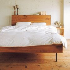 Nice, simple, solid wood with wood grain...change the legs to solid wood, and cut the head board into a mountain scape.