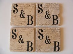 Monogramming on travertine tiles.  LOVE THIS...now to figure out how to do it.