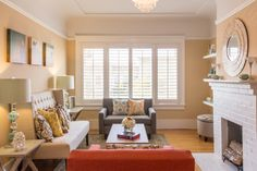 Various shades of blue and oranges give this space pops of color.