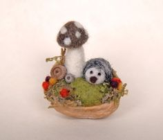 Tiny Hedgehog and Mushroom, Needle Felted, Walnut Shell Art. $26.00, via Etsy.