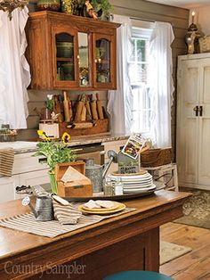 Bring in black-and-cream textiles and galvanized watering cans to repeat a kitchen's neutral features.