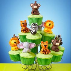 Jungle Fun Cupcakes Scene - Lions, tigers and monkeys … oh my, they certainly make for a wild cupcakes scene that would be great for a birthday party. Display your cupcake creations using the Wilton 13-Ct. Cupcakes-N-More Dessert Stand.