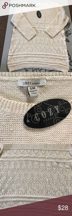 3/4 length sweater. Super cute sweater. Cream colored. NWT. Bought from online boutique. And has cute pattern on bottom half. S/M fits 2-4 cozy Sweaters Crew & Scoop Necks