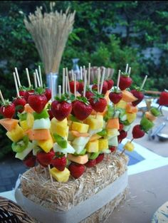 Mother's Day Garden Brunch - Take Home the Dishes (video) Fruit skewers on a hay bale.a delicious way to add color to your Mother's Day Garden Brunch table! See how we displayed ours and what we served them with in this clip. Dessert Party, Buffet Dessert, Snacks Für Party, Appetizers For Party, Fruit Snacks, Fruit Buffet, Bridal Shower Appetizers, Birthday Snacks, Fruit Birthday