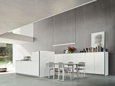 Snaidero ELLE concept, created by Italian designer Monica Armani, strikes a balance between craftsmanship and engineering. ELLE is a kitchen that features stunning open living spaces where architecture does all the talking. It satisfies the desire for minimalist design without depriving itself of eye-catching features. #SnaideroUSA