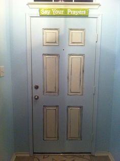 My newly painted front door (interior side)  Base Color - Behr Mineral Water Blue and the original white paint on the door.  Glaze - Behr Lamp Black  Both in satin finish.