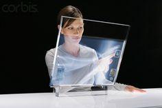 Categoria: 2 / Tags: futuristic, interface, computer / Descrição: protótipo de computador futurista, com interface baseada em toque e tela transparente.
