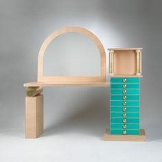 ETTORE SOTTSASS    mirrored console    Renzo Brugola  Italy, 1997  maple veneer with solid maple edging, corrugated aluminum, Abet laminate, gold leaf, glass, turned brass  82.75 w x 23.5 d x 80.5 h