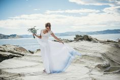 Suzy wore a stunning ombre/dip dye dress for her barefoot beach wedding in New Zealand. Photography by http://www.meredithlord.com/