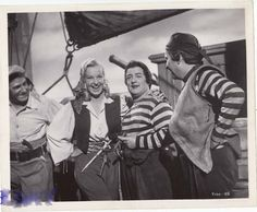 ! A behind the scenes shot of comics Bud Abbott and Lou Costello, with co-star Hillary Brooke, joking around during the filming of the 1952 color comedy, ABBOTT AND COSTELLO MEET CAPTAIN KIDD!...Photo courtesy of Terry Soto Bud Abbott, Abbott And Costello, Female Stars, Comedians, Behind The Scenes, Comedy, Jokes, Meet, My Favorite Things