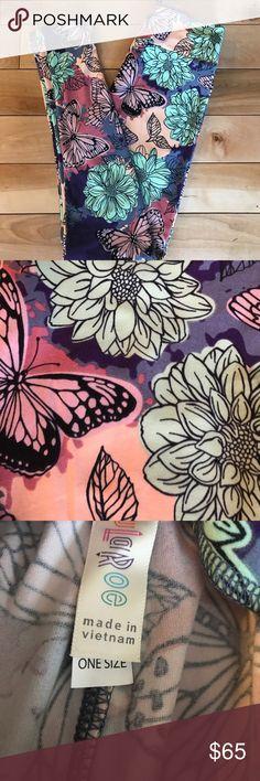 UNICORN Lularoe Dahlia OS leggings UNICORN Lularoe Dahlia OS leggings.  Beautiful spring print with dahlias and butterflies.   Bundle for additional discounts or make me an offer. LuLaRoe Pants Leggings