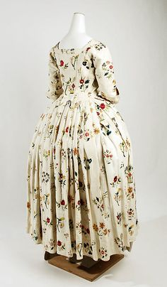 Fashion from 18th century ball gown dress Robe a l  Anglaise circa from British, England in 1725-1750. #Historical #Costume made from linen and silk fabric  with colorful embroidered flowers floral embroidery.  The robe dress is open at the front stomacher and away from the waist towards the sides of the skirt. #Baroque #Rococo #Vintage #Fashion