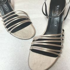 White House Black Market Heels This pair of White House Black Market strapy Heels are beige gold color satin top and leather soles   They are a size 8B and very good condition only worn a couple of times on carpet. White House Black Market Shoes Heels