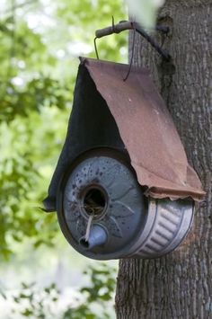 LOVE the reuse and recycle of this old can and piece of rusty metal to create a lovely birdhouse!!!