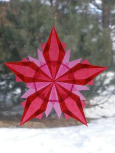 Red and Pink Waldorf-Inspired Origami Window Star by Harvest Moon by Hand.