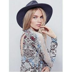 Free People Noveau Gourgous Top Long sleeve Free People Noveau top. Open keyhole back with sheer lace on the shoulders and eyelash trim. high low hem. Mock neck with 2 cute buttons in back. Color: Snow combo Free People Tops Crop Tops