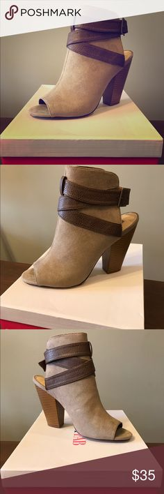 Trendy open toe bootie! Sale ‼️ Limited Time ‼️Perfect summer or fall boot in a versatile taupe color. Features an open toe and adjustable buckle closure. Heel height is about 4 in. Shoes have never been worn. JustFab Shoes Heeled Boots