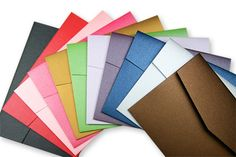 Array of colorful metallic Stardream folders with pockets  http://www.lcipaper.com/metallic-pocketfolds.html