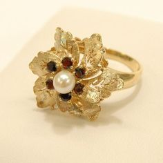 This is what vintage dreams are made of! The floral garnet and pearl ring is available at our Etsy store! #SJJewelers #SmokinJoes #Jewelry #vintage