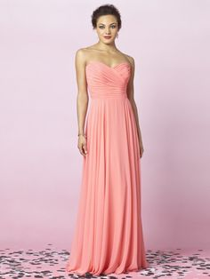 long light salmon color bridesmaid dress, maybe get a light turquoise blue sash to go around the boddes.