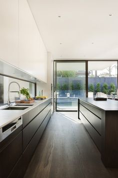 linear kitchen, window instead of back splash (cleaning?), white upper cabinets, wooden lower cabinets, like kitchen layout but not the rest