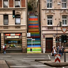 Scala (Rainbow Staircase), in Wuppertal, Germany. Artist Horst Gläsker took a drab staircase wedged in between two buildings in the town of Wuppertal and painted it a rainbow of colors, transforming an eyesore into a bright, energetic spot. Stairway To Heaven, Stairway Art, Beautiful Stairs, Beautiful Streets, World's Most Beautiful, Wuppertal Germany, Escalier Art, Performance Artistique, Outdoor Steps