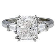 Platinum ring by Harry Winston with center 2.57 carat Radiant cut diamond and two baguette cut diamonds weighing 0.45 carat. Diamond comes with GIA report #13295609 dated may 12, 2004 stating F color and VS1 clarity.