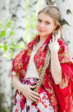 Just another typical Russian beauty, but there us something sophisticated and stylish about her. Maybe the bold way she combines bright red with neutral. A great match.