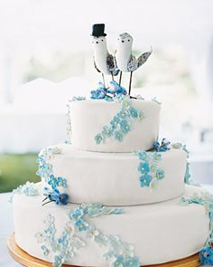 The tiny blue flowers and custom topper on this cake make it irresistibly whimsical