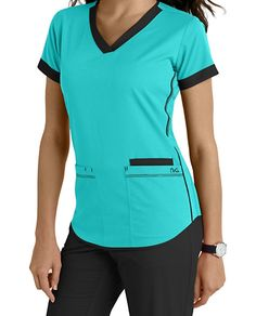 NrG by Barco brings to you this cute scrub top highlighted by contrast banded sleeves, neck and piping details on sides and hem. V-neck Three pockets Fitted back Contrast details Medium center back length 26 Dental Uniforms, Healthcare Uniforms, Vet Scrubs, Medical Scrubs, Scrubs Outfit, Scrubs Uniform, Stylish Scrubs, Cute Nurse, Nursing Clothes