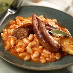 husband-approved!   slow-carb diet approved (subtract the cheese)!   Cannellini Beans and Italian Sausage