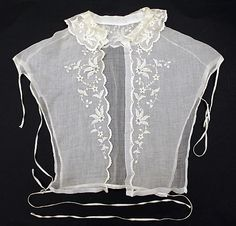 "1850-1869, the kind of lace collar--what we might call a ""dickey""--that would be worn with an 1850s dress along with similarly light lace undersleeves. In addition to adding a decorative touch, these pieces kept the main bodice from being soiled at key places...important in a day when there was really no way to fully clean, say, a wool dress."
