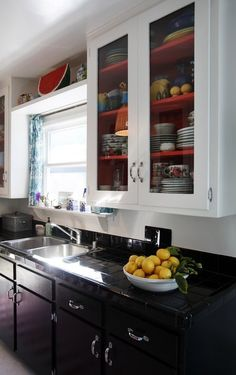 Kitchen inspiration: matching paint for cabinets and tile (to hide the age of the tile). Also: bright cabinet interiors!