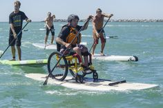 Charles Webb, a paraplegic athlete who started paddleboarding earlier this summer on an adaptive board, finishes the 4-mile open water race Saturday. ©RainbowSandals/Tom Servais. >>> See it. Believe it. Do it. Watch thousands of SCI videos at SPINALpedia.com