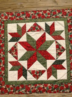 Christmas star wall hanging quilt. Think this would stay on the wall all year!