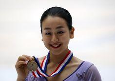 Mao Asada of Japan poses with her medal after winning the ladies free skating program during China ISU Grand Prix of Figure Skating, in Beijing, China, November 7, 2015. REUTERS/Kim Kyung-Hoon (3500×2464)