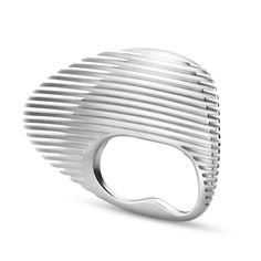 Architect Zaha Hadid has designed a collection of silver jewellery,  including a twisted cuff and a ring that fits over two fingers which bears a resemblance to Hadid's pebble-shaped Wangjing Soho towers in Beijing, which was completed in 2015.