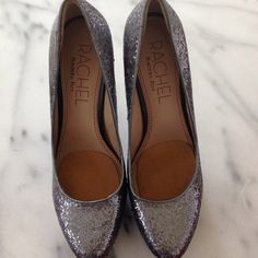 Blue Steel glitter platform heels by Rachel Roy Rachel by Rachel Roy blue gray glitter round toe platform pumps with full gunmetal pyramid stud heels. Never worn but shoe pads at toe and on back of heels were placed in. Size and 9.5 Rachel Roy Shoes Heels