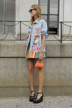 A patch-work denim vest and rainbow skirt