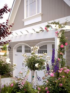 arbor over garage and gray + white trim