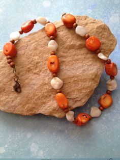 A personal favorite from my Etsy shop https://www.etsy.com/listing/162776811/orange-coral-and-natural-mother-of-pearl