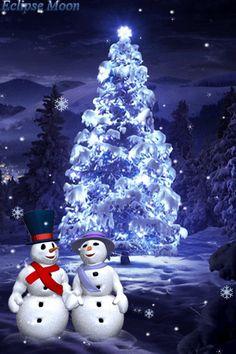 Snowmen near the tree in winter forest