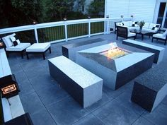 Beautiful glass fire pit patio deck. I wonder if this gets hot during the summer?  Still 1 of the 10 Best Decks & Patios we could find. Worth saving for creative ideas/use later! via. @C ompact Power Equipment Rental #DIY #Deck #Patio