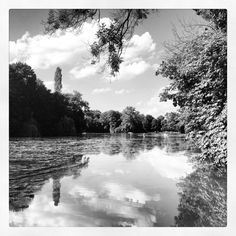 Beautiful photo of a lake in the english garden munich black and white photography by ines