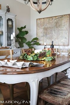 simple greenery and mercury glass makes this French farmhouse style dining room all set for Christmas!