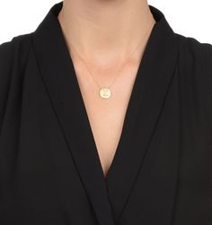 This chic necklace features a solid 14k gold disc with your choice of one single initial crafted using beautiful white diamonds. A classic piece every woman should have in her jewelry wardrobe. Available at stoneandstrand.com - $745.