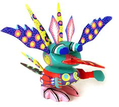 Oaxacan Wood Carvings Carmelo Sosa Martian. We have one similar to this in our collection! It's an alebrije